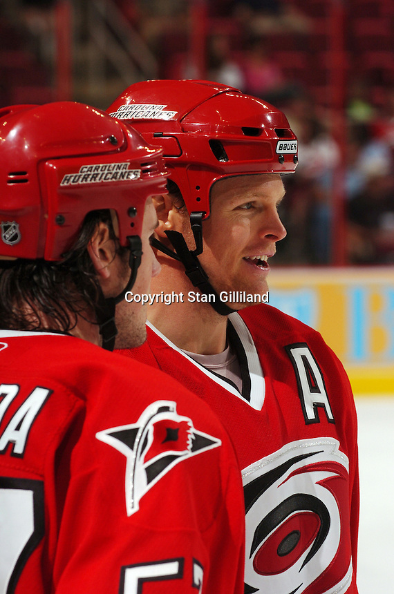 Carolina Hurricanes' Kevyn Adams talks things over with a teammate during a game with the Tampa Bay Lightning Thursday, Sep. 22, 2005 in Raleigh, NC. Carolina won 5-2.