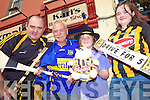 CLASH OF THE ASH: Killorglin chef Paddy Brennan from Kilkenny and Killorglin barber Karl Daly from Tipperary cross hurleys ahead of Sunday's All-Ireland Hurling Final with Paddy's daughter's Enya and Dearbhla.