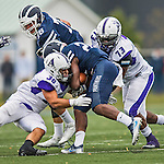 8 October 2016: Amherst College Purple & White Offensive Linebacker Andrew Yamin, a Sophomore from Cheshire, CT, and Defensive Lineman Niyi Odewade, a Senior from Newark, NJ, tackle Middlebury College Panther Running Back Diego Meritus, a Sophomore from Yarmouthport, MA, at Alumni Stadium in Middlebury, Vermont. The Panthers edged out the Purple & While 27-26. Mandatory Credit: Ed Wolfstein Photo *** RAW (NEF) Image File Available ***