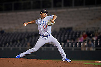 Mesa Solar Sox relief pitcher Adbert Alzolay (61), of the Chicago Cubs organization, watches the action on the field during an Arizona Fall League game against the Scottsdale Scorpions on October 23, 2017 at Scottsdale Stadium in Scottsdale, Arizona. The Solar Sox defeated the Scorpions 5-2. (Zachary Lucy/Four Seam Images)