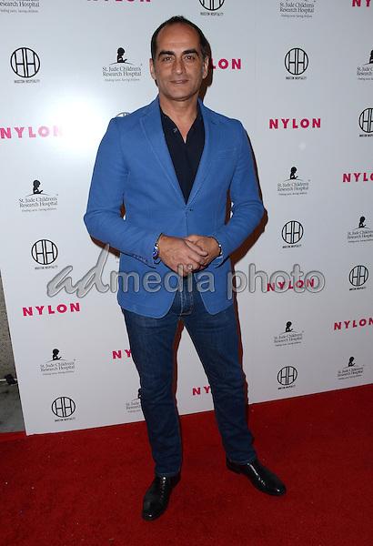 09 February  - Hollywood, Ca - Navid Negahban. Arrivals for the NYLON Magazine Pre-Grammy Party held at No Vacancy. Photo Credit: Birdie Thompson/AdMedia
