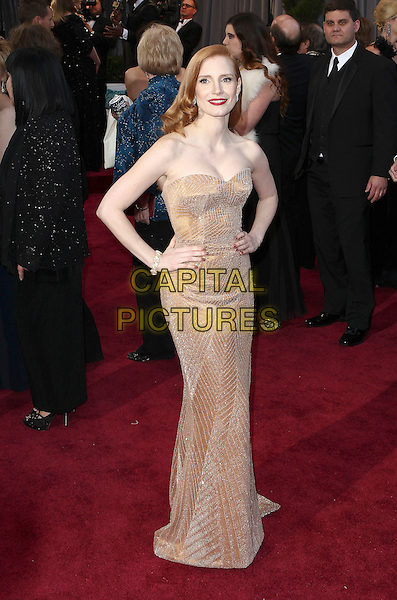 Jessica Chastain (wearing Armani Prive).85th Annual Academy Awards held at the Dolby Theatre at Hollywood & Highland Center, Hollywood, California, USA..February 24th, 2013.oscars full length blush strapless dress gown sweetheart neckline gold sparkly hands on hips.CAP/ADM/SLP/COL.©Colin/StarlitePics/AdMedia/Capital Pictures