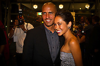 "GOLD COAST, Queensland/Australia (Friday, February 24, 2012) Kelly Slater (USA)  x 11 World Champion and girlfriend Kalani Miller (USA). – The 29th Annual ASP World Surfing Awards went off tonight at the Gold Coast Convention and Exhibition Centre with the world's best surfers trading the beachwear for formal attire as the 2011 ASP World Champions were officially crowned.. .Kelly Slater (USA), 40, and Carissa Moore (HAW), 19, took top honours for the evening, collecting the ASP World Title and ASP Women's World Title respectively.. .""I have actually been on tour longer than some of my fellow competitors have been alive,"" Slater said. ""All joking aside, it's truly humbling to be up here and honoured in front of such an incredible collection of surfers. I want to thank everyone in the room for pushing me to where I am.""..In addition to honouring the 2011 ASP World Champions, the ASP World Surfing Awards included new accolades voted on by the fans and the surfers themselves...For the first time in several years, ASP Life Membership was awarded to Hawaiian legend and icon of high-performance surfing, Larry Bertlemann (HAW), 56...""Where surfing is today is where I dreamed it should be in the 70's,"" Bertlemann said. ""You guys absolutely deserve this and I'm so honored to be up here in front of you all tonight."".Grammy Award-winning artists Wolfmother and The Vernons rounded out the night's entertainment which was all streamed LIVE around the world on YouTube.com..Photo: joliphotos.com"
