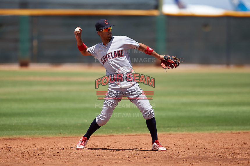 AZL Indians Red shortstop Yordys Valdes (10) throws to first base during an Arizona League game against the AZL Indians Blue on July 7, 2019 at the Cleveland Indians Spring Training Complex in Goodyear, Arizona. The AZL Indians Blue defeated the AZL Indians Red 5-4. (Zachary Lucy/Four Seam Images)