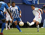 10 June 2007: Mexico's Pavel Pardo (8) takes a shot past Honduras' Emilio Izaguirre (21). The Honduras Men's National Team defeated the National Team of Mexico 2-1 at Giants Stadium in East Rutherford, New Jersey in a first round game in the 2007 CONCACAF Gold Cup.