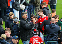 Barnsley's Liam Lindsay is mobbed as fans run onto the pitch after the match<br /> <br /> Photographer Alex Dodd/CameraSport<br /> <br /> The EFL Sky Bet League One - Barnsley v Blackpool - Saturday 27th April 2019 - Oakwell - Barnsley<br /> <br /> World Copyright © 2019 CameraSport. All rights reserved. 43 Linden Ave. Countesthorpe. Leicester. England. LE8 5PG - Tel: +44 (0) 116 277 4147 - admin@camerasport.com - www.camerasport.com