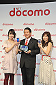 February 24, 2011 - Tokyo, Japan - Ryuji Yamada (C), president and CEO of NTT Docomo, hold up the smartphone Medias tablet during the company's press conference with actress Aki Asakura (L) and Mako Ishino (R). NTT Docomo unveils three new smartphone models: the XPERIA, the Medias and the Optimus. (Photo by Koichi Mitsui/AFLO)