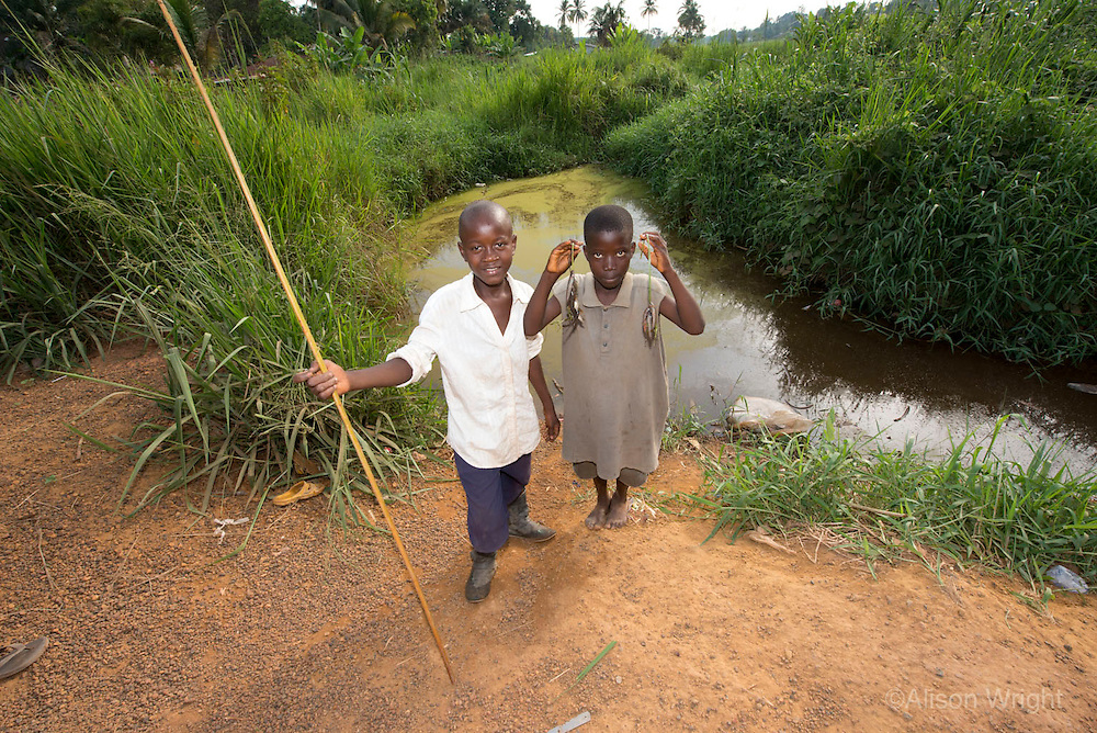 Boys fishing. Kakata, Liberia, Africa.