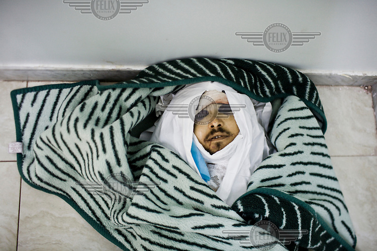 The body of a rebel fighter waits to be collected for burial from the Al-Hekma hospital. On 17 February 2011 Libya saw the beginnings of a revolution against the 41 year regime of Col Muammar Gaddafi.