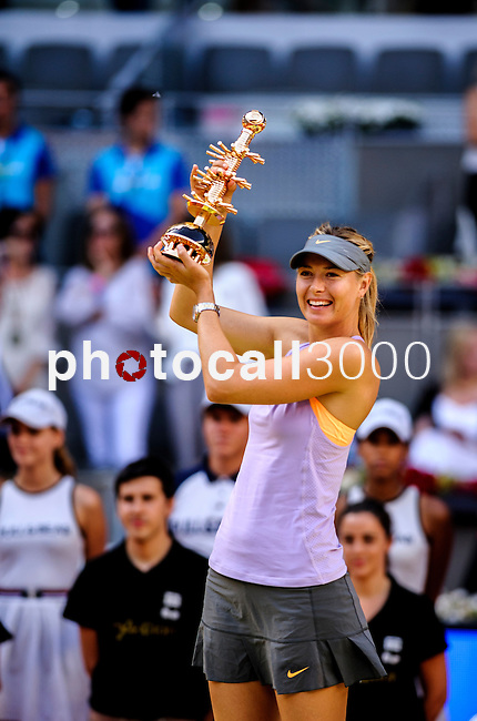 """Russian tennis player Maria Sharapova poses after winning the women's singles final tennis match against Romanian tennis player Simona Halep at the Madrid Masters at the """"Caja Magica"""" sports complex in Madrid on May 11, 2014.<br /> <br /> Photocall3000/Daniel Calleja"""
