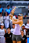 "Russian tennis player Maria Sharapova poses after winning the women's singles final tennis match against Romanian tennis player Simona Halep at the Madrid Masters at the ""Caja Magica"" sports complex in Madrid on May 11, 2014.<br /> <br /> Photocall3000/Daniel Calleja"