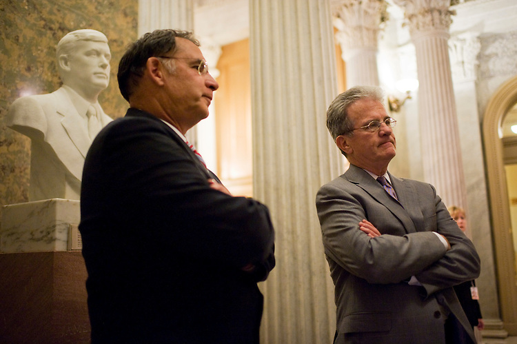 UNITED STATES - JULY 29:  Sens. John Boozman, R-Ark., left, and Tom Coburn, R-Okla., talk with a visitor after a vote on the motion to table the motion to concur with the House passed debt limit increase bill.(Photo By Tom Williams/Roll Call)