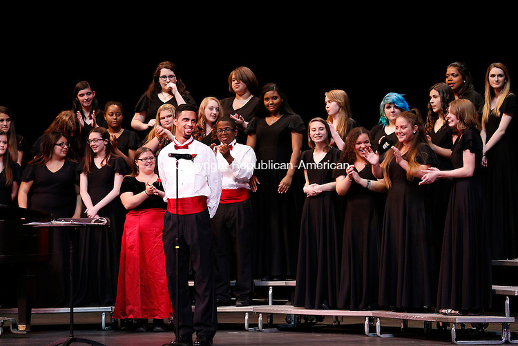 Torrington, CT- 21 May 2015-052115CM11-  Torrington High School senior, and member of the concert choir, James Pittman, is recognized by fellow students during Torrington High School Music Department's farewell concert at the Warner Theatre in Torrington on Thursday.  The department held the concert to honor the graduating  seniors.  Christopher Massa Republican-American