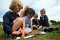 THE ISLES OF SCILLY SEABIRD RECOVERY PROJECT. JACLYN PEARSON, RSPB, ENLISTS LOCAL SCHOOL CHILDREN TO STUDY SCILLY SHREW POPULATIONS BY PUTTING OUT INK TRAPS.  17/06/2015. PHOTOGRAPHER CLARE KENDALL.