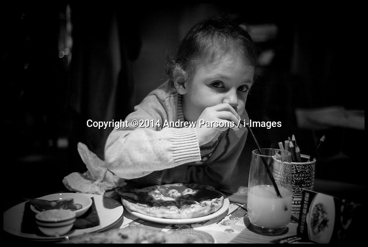 Image ©Licensed to i-Images Picture Agency. 29/10/2014. London, Yasmin Parsons having a pizza in Pizza Express after having her CT scan on her chest at Great Ormond Street Hospital. Picture by Andrew Parsons / i-Images