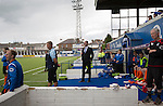 Queen of the South 2 Stranraer 0, 11/08/2015. Scottish Challenge Cup first round, Palmerston Park. Visiting manager Brian Reid (black suit) watching the second-half action at Palmerston Park, Dumfries, as Queen of the South (in blue) host Stranraer in a Scottish Challenge Cup first round match. The game was the opening match of the season in a competition open to sides below the Scottish Premiership. Queen of the South won the match 2-0, watched by a crowd of 1229 spectators. Photo by Colin McPherson.