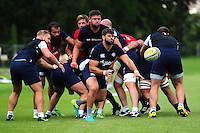 Guy Mercer of Bath Rugby passes the ball. Bath Rugby pre-season training session on August 9, 2016 at Farleigh House in Bath, England. Photo by: Patrick Khachfe / Onside Images