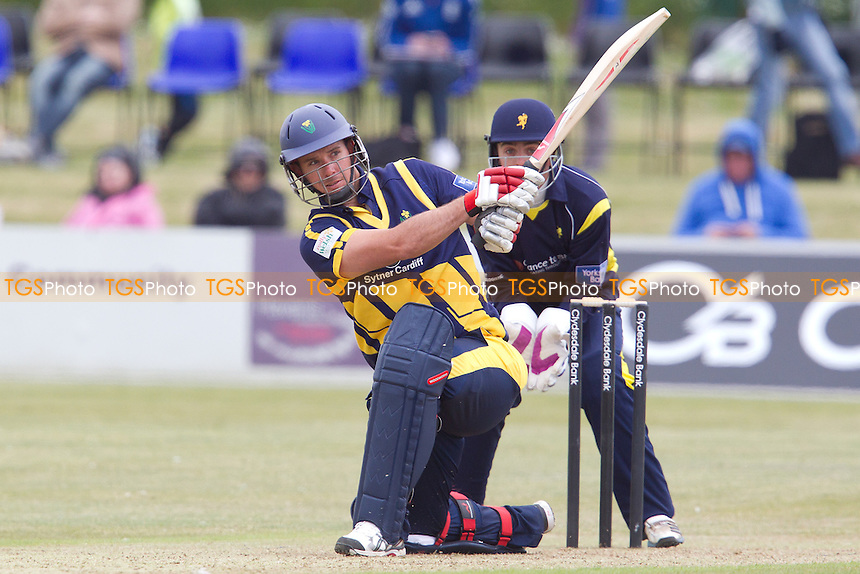 Jim Allenby, Glamorgan CCC collects a maximum over mid wicket - Unicorns vs Glamorgan CCC - Yorkshire Bank YB40 Cricket at Garon Park, Southend-on-Sea - 09/06/13 - MANDATORY CREDIT: Ray Lawrence/TGSPHOTO - Self billing applies where appropriate - 0845 094 6026 - contact@tgsphoto.co.uk - NO UNPAID USE
