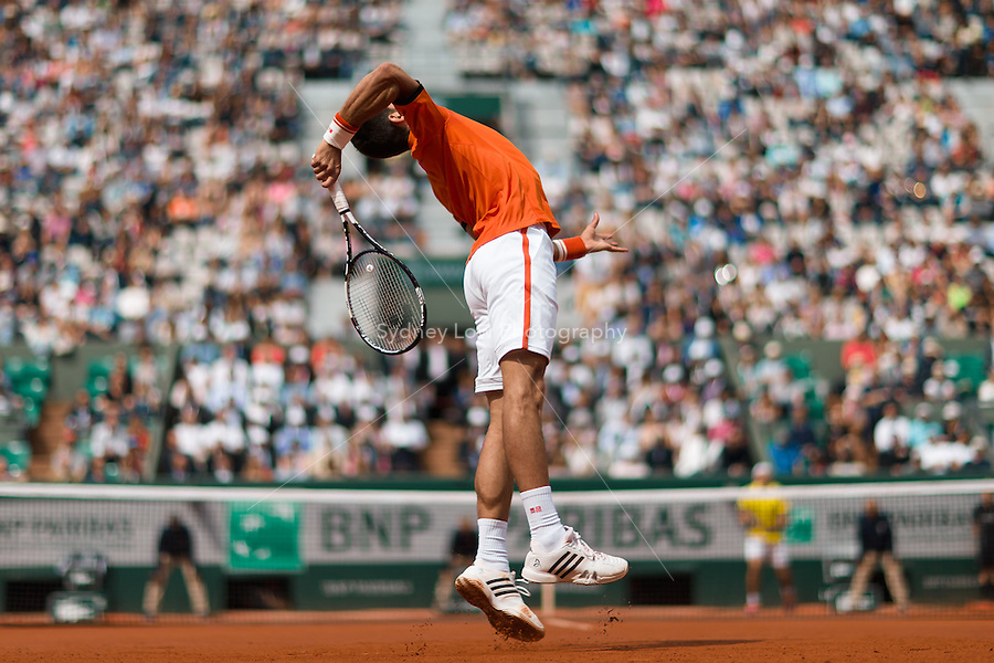 May 28, 2015: Novak DJOKOVIC of Serbia in action in a 2nd round match against Gilles MULLER of Luxembourg on day five of the 2015 French Open tennis tournament at Roland Garros in Paris, France. Sydney Low/AsteriskImages