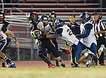 Lawndale, CA 10/07/16 - Hunter Williams (Lawndale #5), Anthony Runnell (Santa Monica #23) and Elijah Gonzalez (Santa Monica #54) in action during the CIF Bay League game between Santa Monica and Lawndale.
