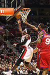 12/26/11--Trail Blazers forward Gerald Wallace makes a reverse layup over 76ers' Elton Brand  in the home-opener at the Rose Garden..Photo by Jaime Valdez. .........................................