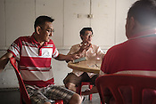 61 year old Lay Kee Tee, a former pig farmer and a  survivor of the Nipah virus spends time with his friends at a Chinese cafe in Bukit Pelandok in Nageri Sembilan, Malaysia on October 16th, 2016. <br /> In September 1998, a virus among pig farmers (associated with a high mortality rate) was first reported in the state of Perak in Malaysia. Dr. Chua investigated and discovered the virus and it was later named, Nipah Virus. The outbreak in Malaysia was controlled through the culling of &gt;1 million pigs.