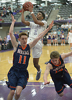 NWA Democrat-Gazette/ANDY SHUPE<br /> Jon Conley (2) of Fayetteville takes a shot in transition as Ty Olsen (11) and Bryce Breedlove of Heritage defend Tuesday, Feb. 13, 2018, during the first half of play in Bulldog Arena in Fayetteville. Visit nwadg.com/photos to see more photographs from the games.