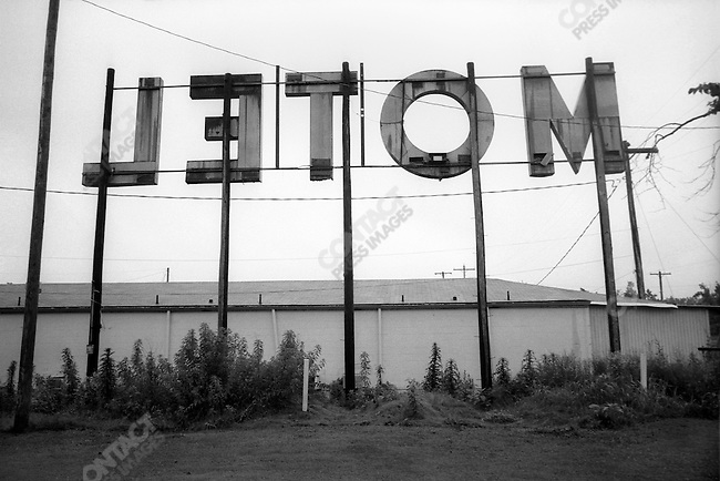 """Route 66: Reversed """"MOTEL"""", (LETOM) from behind a motel in Lebanon, MO."""