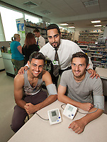 ASDA Old Mill Lane's new pharmacy has opened, two of the first visitors taking advantage of a free blood pressure check were Mansfield Town players Ryan Tafazolli (left) and Andy Owens who are pictured with Pharmacy Manager AJ (centre)                            .