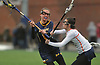 Jaclyn Gatti #19 of Massapequa, left, takes a shot that found the back of the net in a Nassau County varsity girls lacrosse game against host Manhasset High School on Tuesday, March 27, 2018. She scored four goals in defeat as Manhasset won by a score of 11-8.