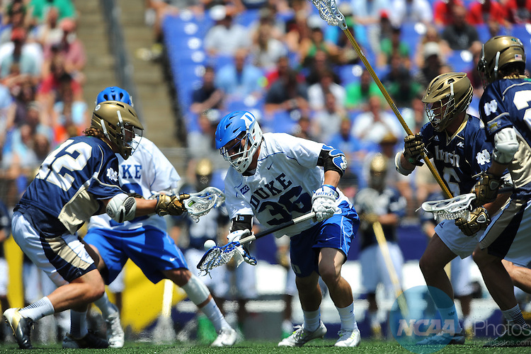 26 MAY 2014:  Notre Dame defenders surround Jack Bruckner (36) of the Duke Blue Devils during the Division I Men's Lacrosse Championship at M&T Bank Stadium in Baltimore, MD.  Duke defeated Notre Dame 11-9 for the national title.  Larry French/NCAA Photos
