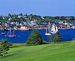 Lunenburg County, Nova Scotia<br /> Painted houses and buildings of Lunenburg rise on a hill above the blue waters and sailboats in the town harbor