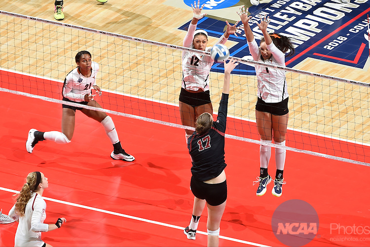 COLUMBUS, OH - DECEMBER 17:  Morgan Johnson (12) and Micaya White (1) of the University of Texas jump for a block against Stanford University during the Division I Women's Volleyball Championship held at Nationwide Arena on December 17, 2016 in Columbus, Ohio.  Stanford defeated Texas 3-1 to win the national title. (Photo by Jamie Schwaberow/NCAA Photos via Getty Images)