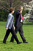 """United States President George W. Bush flashes a """"thumbs-up"""" as he and first lady Laura Bush walk across the South Lawn of the White House in Washington, DC to Marine 1 on April 6, 2001.  They were departing the White House for Milwaukee, Wisconsin where the President was to throw out the first ball at the Milwaukee Brewers vs. Cincinnati Reds baseball game.<br /> Credit: Ron Sachs / CNP"""