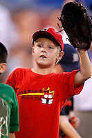July 28, 2009:  A young fan asking for a ball during a game at Coca-Cola Field in Buffalo, NY.  Photo By Mike Janes/Four Seam Images