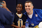 Kurt Warner has his photo taken with Fredrick Tate, 8, from St. Louis. Fredrick plays cornerback for a Pop Warner football team, the North County Falcons. Fredrick's mother, Monique Tate is taking the photo. She is a school teacher in East St. Louis, in the #189 school district.