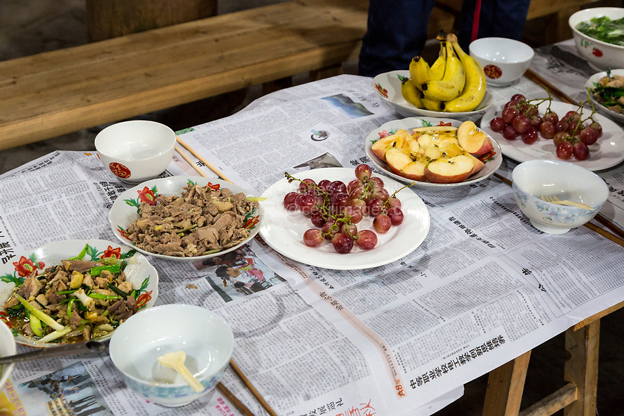 Huanggang, Guizhou, China.  A Dong Ethnic Village.  Lunch for Visiting Tourists.