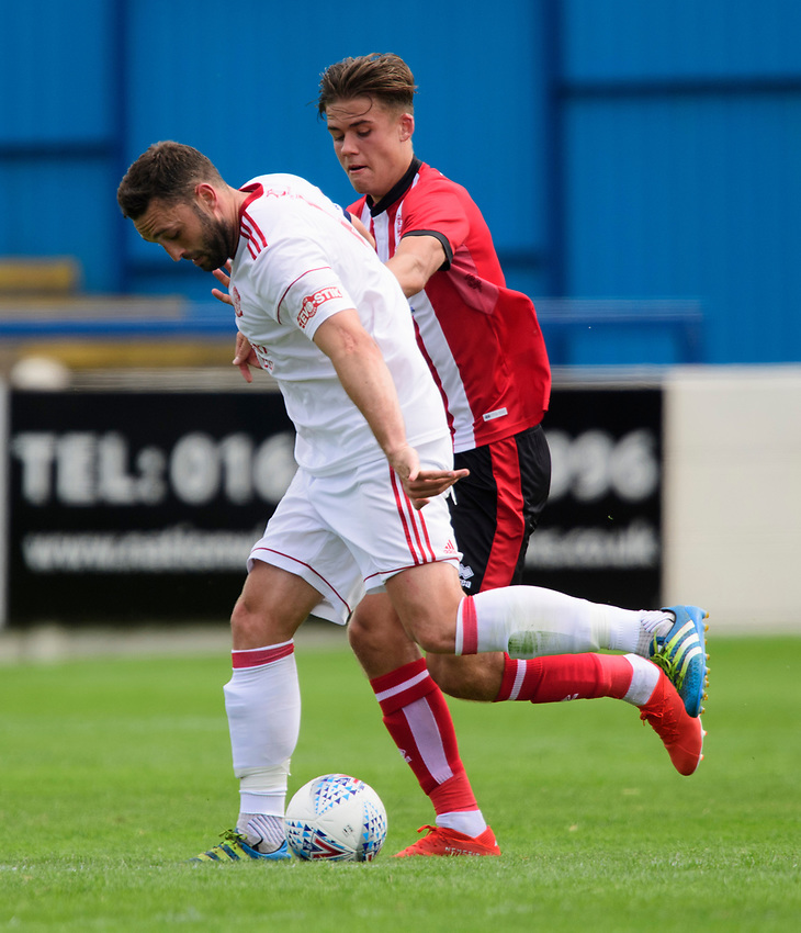 Lincoln United's Matt Wilson vies for possession with Lincoln City's trialist<br /> <br /> Photographer Chris Vaughan/CameraSport<br /> <br /> Football Pre-Season Friendly (Community Festival of Lincolnshire) - Lincoln City v Lincoln United - Saturday 6th July 2019 - The Martin & Co Arena - Gainsborough<br /> <br /> World Copyright © 2018 CameraSport. All rights reserved. 43 Linden Ave. Countesthorpe. Leicester. England. LE8 5PG - Tel: +44 (0) 116 277 4147 - admin@camerasport.com - www.camerasport.com