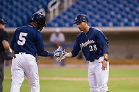 AZL Brewers manager Rafael Neda (28) congratulates shortstop Jean Carmona (5) after hitting a home run against the AZL Padres 2 on September 2, 2017 at Maryvale Baseball Park in Phoenix, Arizona. AZL Brewers defeated the AZL Padres 2 2-0. (Zachary Lucy/Four Seam Images)