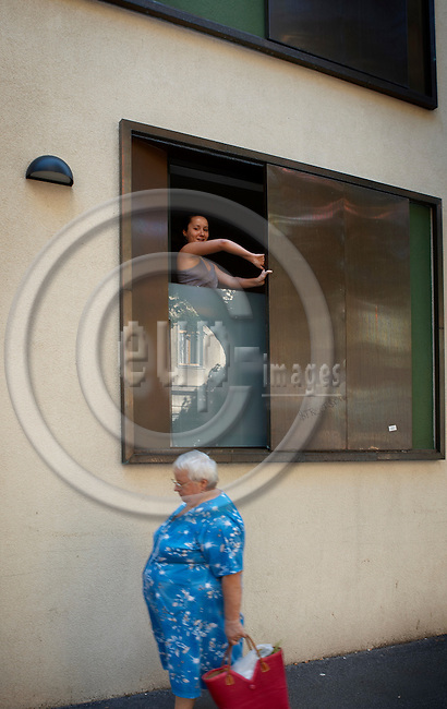 """VIENNA - AUSTRIA 17. AUGUST 2006 --  Emanuela Ruse, student from Rumania pulls the window shutter - The low energy house in Molkereistrasse 1 in Vienna is owned by The Austrian Exchange Service (÷AD) and used as a dormitory (G?stehaus der Wiener Universit?ten /FHs) for foreign students -- PHOTO: CHRISTIAN T. JOERGENSEN / EUP & IMAGES..This image is delivered according to terms set out in """"Terms - Prices & Terms"""". (Please see www.eup-images.com for more details)"""