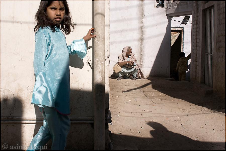 street scene in the Islamabad slum called 'France Colony'