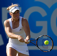 Melanie Oudin (USA) against Samantha Stosur (AUS) in the first round of the women's singles. Samantha Stosur beat Melanie Oudin 6-4 6-4..International Tennis - 2010 Sony Ericsson WTA Tour - AEGON International - Devonshire Park Lawn Tennis Centre - Eastbourne - Day 1 - Mon 14 Jun 2010..© FREY - AMN Images - Level 1, 20-22 Barry House, 20-22 Worple Road, London, SW19 4DH.Tel - +44 (0) 208 947 0100.Email - mfrey@advantagemediannet.com.web - www.advantagemedianet.com