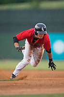 Eddy Alvarez (1) of the Kannapolis Intimidators dives back into first base during the game against the Lakewood BlueClaws at CMC-Northeast Stadium on May 16, 2015 in Kannapolis, North Carolina.  The BlueClaws defeated the Intimidators 9-7.  (Brian Westerholt/Four Seam Images)