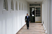 United States President Barack Obama walks along the colonnade of the White House leading from the residence to the Oval Office a few hours before he delivers the State Of The Union speech on January 28, 2014 in Washington, DC.<br /> Credit: Kristoffer Tripplaar  / Pool via CNP