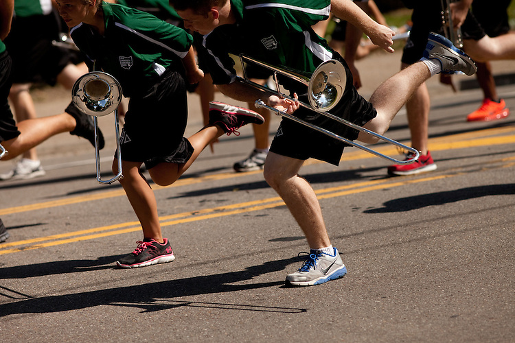 Led by the Marching 110, Ohio University's 2013 freshman class marches to the College Green in Athens, Ohio on Sunday, August 25, 2013. Photo by Chris Franz