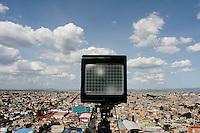 "Photographer Sze Tsung Leong shooting part of his ""Horizons"" series on an 8x10 camera. Panoramic views of Ciudad Nezahualcoyotl, part of Mexico City's urban sprawl."