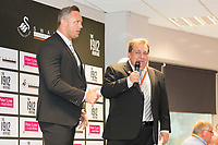 Lee Trundle and Kev Johns talk in the 1912 Heritage Experience in the Gower Suite with adverts from Peter Lynn and Partners Solicitors prior to kick off of the Premier League match between Swansea City and Leicester City at The Liberty Stadium, Swansea, Wales, UK. Saturday 21 October 2017