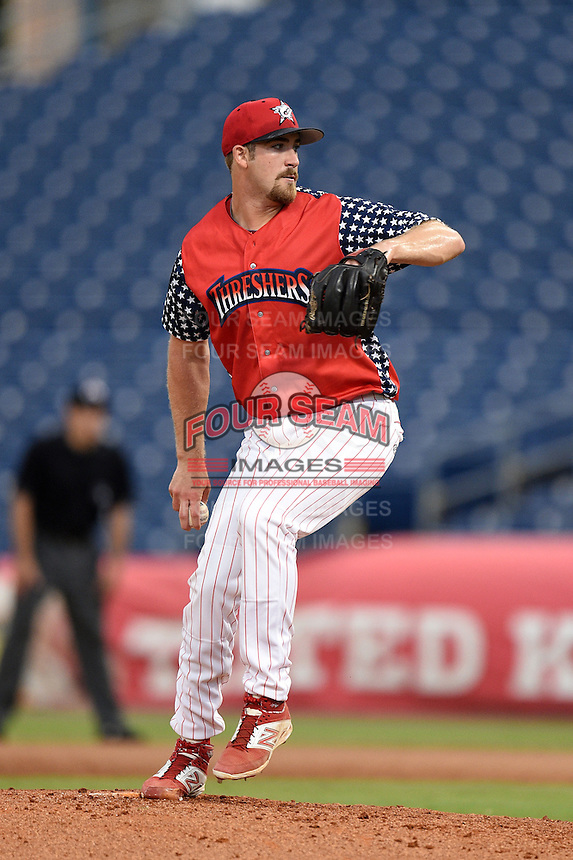 Clearwater Threshers pitcher Lee Ridenhour (34) delivers a pitch during a game against the Brevard County Manatees on June 28, 2014 at Bright House Field in Clearwater, Florida.  Brevard County defeated Clearwater 6-4.  (Mike Janes/Four Seam Images)