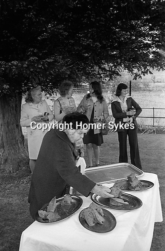 The Wicken Love Feast, takes place on Ascension Day and celebrates the joining together of two parishes in 1587. Feast laid out under the Gospel Elm.  Wicken Northamptonshire 1970s Uk. <br /> <br /> My ref 10a/1371/1976
