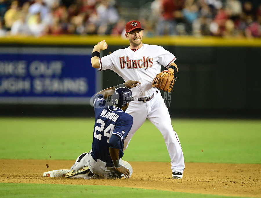 Jul. 3, 2012; Phoenix, AZ, USA: Arizona Diamondbacks shortstop Stephen Drew throws to first base to complete the double play after forcing out San Diego Padres base runner Cameron Maybin in the fifth inning at Chase Field. Mandatory Credit: Mark J. Rebilas-